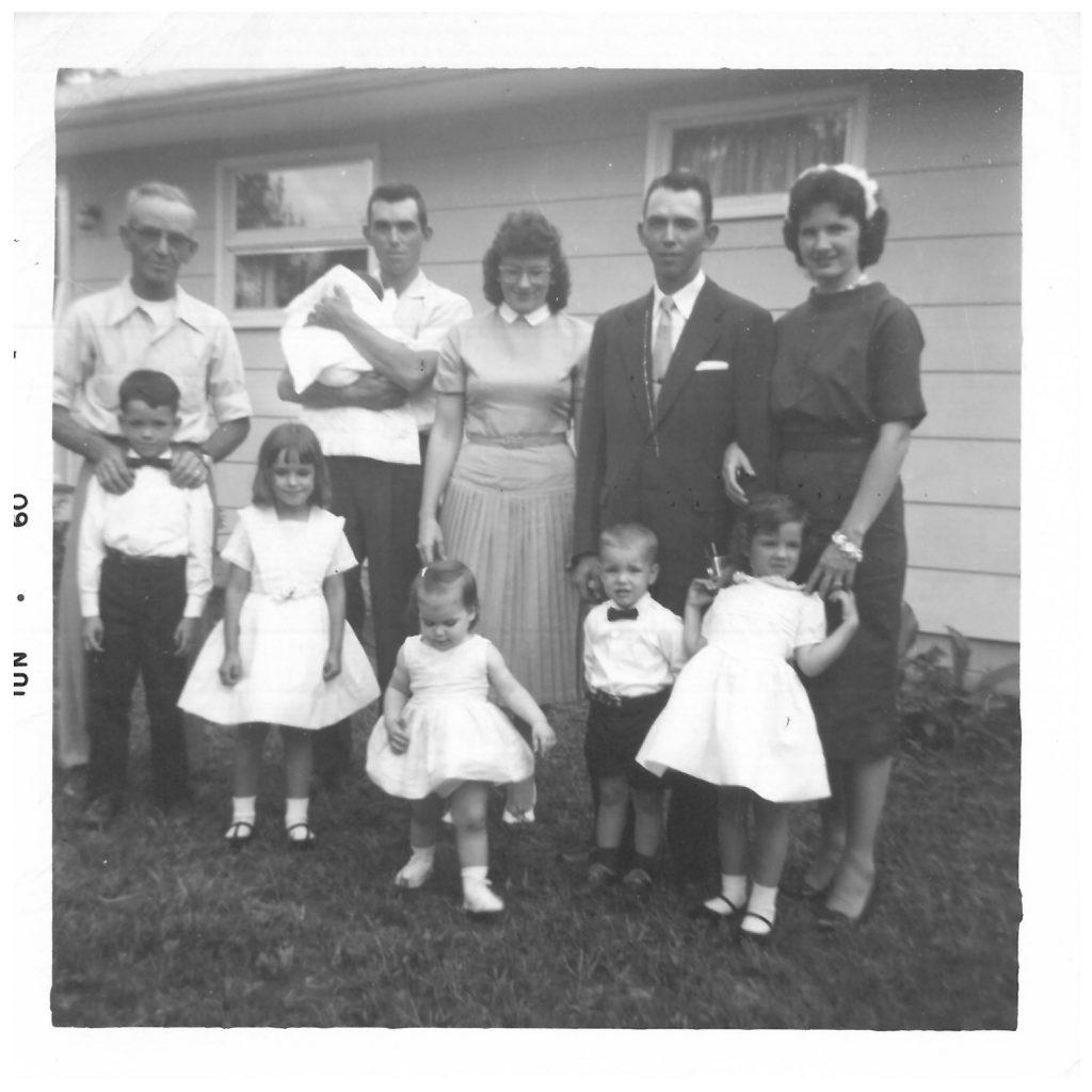 Dutch, Gerald, baby Tracy, Genny, Dwight, Gerry 2nd Row: Dad, Linda, Rhonda, Steven, Susan